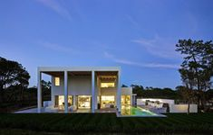 design San Lorenzo North House Portuguese Building With Double Height Portico Overlooking a Golf Course