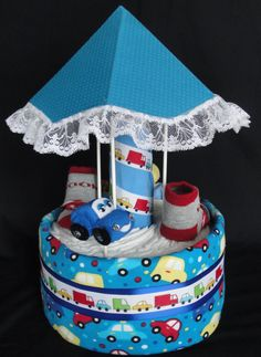Car carousel diaper cake http://www.facebook.com/DiaperCakesbyDiana