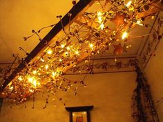What a cool idea! Hanging ladder with berry garland, or grapevine and string lights. Use as a chandelier! Antique Ladder, Old Ladder, Rustic Ladder, Wooden Ladder, Hanging Ladder, Hanging Lights, String Lights, Ladder Decor, Room Lights