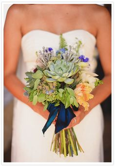 The vibrancy of the blue is a great contrast to the succulents, making this a truly distinguished yet personal bouquet.     via 100layercake.com