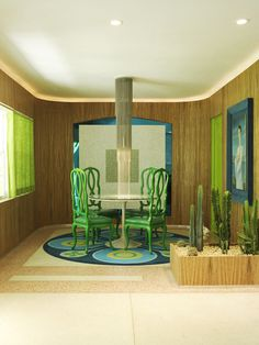 Doug Meyer Interior  Doug and Gene Meyer Studio, green dining chairs, veneer zebra wood walls.