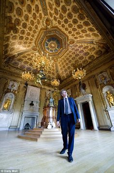 The Daily Mail's Robert Hardman admires the ceiling in one of the King's State Rooms.