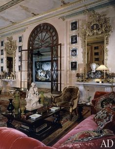 Fashion designer Hubert de Givenchy inspired Pinto to acquire a 1920s-era apartment in Paris (AD, April 1993). In the main salon, the framed images are Pompeian wall studies and the sculpture on the cocktail table is by Albert-Ernest Carrier-Belleuse. In the hall beyond hangs a hunting scene by Frans Snyders.