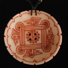 SOUTHERN: CHEROKEE This is a handcarved shell called a gorget. The design is a traditional southeastern design revived from archeological digs. The image is of a woodpecker and a four directional symbol in the center.