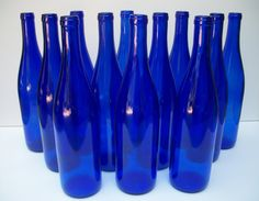 Clancy likes!! Cobalt Blue Wine Bottles by ThroughTheWindowPane on Etsy, $4.00 For the aisle flowers?
