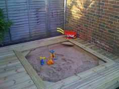 sand pit in deck love this no sand in the grass....or less at least!