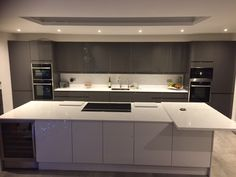 This contemporary Bayswater Gloss kitchen in Grey was designed by our Sutton depot. For more inspiration, visit Howdens.