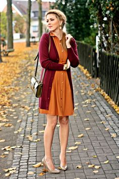 Shop this look on Lookastic:  http://lookastic.com/women/looks/open-cardigan-watch-casual-dress-crossbody-bag-pumps-earrings/4419  — Burgundy Open Cardigan  — Gold Watch  — Orange Casual Dress  — Olive Leather Crossbody Bag  — Brown Leather Pumps  — Gold Earrings