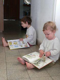 children reading, enjoying books