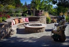 Always wanted an outdoor fireplace, but love the pit idea.  The curved wall/bench is a great place!