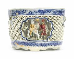 A rare reticulated blue and white 'cold-painted' cup, 17th century