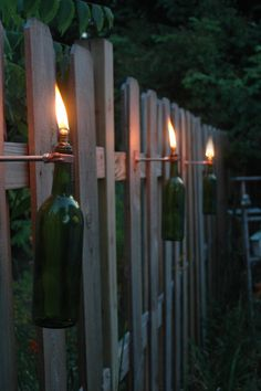 6 Wine Bottle Tiki Torches in your color choice of Red, Cobalt Blue, Frosted White, Green or Amber via Etsy