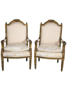 Very fine carved pair of armchairs. These wonderfully study chairs are done in the Louis XVI taste having a distressed gilt gold wooden finish.    TheHighBoy    #highboystyle #antiquesmakeitbetter #antiques #vintagefurniture #homedecoration #seating