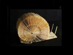 Snail made out of book pages. Book art