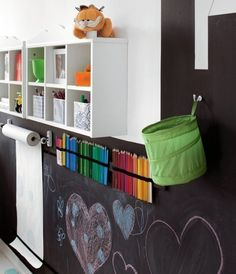 I love this blackboard wall in the kids playing area. What a great way to store art and craft supplies.