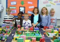 Second grade social studies community project.  Kids named the elements that communities need, constructed them from scrap materials and decided how to group them on the model.