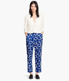 Wide-cut pants in woven crêpe fabric with a printed pattern. Pleats at top, side pockets, and back pockets. Gently tapered to leg hems. - Visit hm.com to see more.