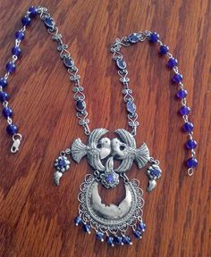 Sterling Mazahua necklace with doves, moon, leaves and filigree chain with amethysts cabochons by Tita Rubli Silver Jewelry.