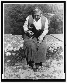 Portrait of Gertrude Stein, with dog Pepe, Biliguin. Photographed by Carl Van Vechten, June 12, 1934.