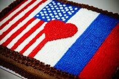 The American groom surprised his Russian bride with this groom's cake featuring the flags of both countries