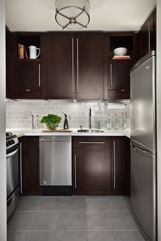 Sleek and Contemporary NYC Kitchen. LIke the shades of brown & beige with the stainless steel
