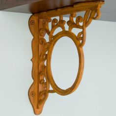 "Circle Motif with Floral Scrollwork Cast Iron Shelf Bracket - 8-5/8"" x 8-5/8"" - Rust by Whittington Collection. $28.95. The central circle motif is surrounded by beautiful floral scrollwork on this iron shelf bracket. Available in two iron finishes. Shown in Rust finish. Bracket dimensions: 8-5/8 L x 8-5/8 H. Bracket is 1-7/8 wide. Made of durable cast iron. Rust finish is actual oxidized iron, a living finish. Sold individually. Includes matching fastening hardware."
