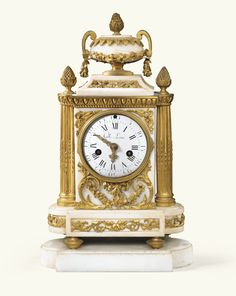A GILT-BRONZE MOUNTED WHITE MARBLE MANTEL CLOCK, LOUIS XVI, THE DIAL SIGNED GILLE L'AÎNÉ