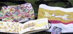 Bolsas, capa de celular e caderno de desenho com cachorrinhos e papéis coloridos