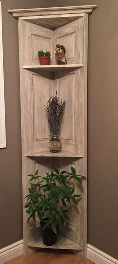 Saved a door from going to the landfill and made it into a corner shelf using scraps of wood and a chalk paint recipe found on Pinterest