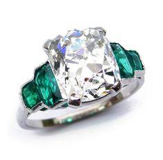 Art Deco single stone cushion diamond and emerald ring, c.1930, the claw set…