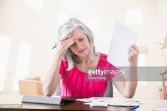 Stockfoto : Frustrated Caucasian woman paying bills online