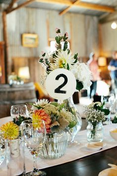 #table-numbers, #centerpiece  Photography: Louisa Bailey - Louisabailey.com  Read More: http://www.stylemepretty.com/australia-weddings/2014/06/10/laid-back-rustic-barn-wedding/