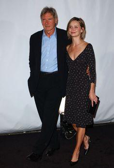 Calista Flockhart and Harrison Ford honor Giorgio Armani in 2003.