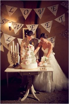Wedding cake table and back ground sign