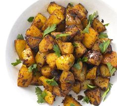 Spanish Potatoes 2 tbsp oil 3 tbsp tomato purée 1 tsp smoked paprika 800g potatoes , cut into small chunks 4 garlic cloves juice ½ lemon handful flat-leaf parsley leaves, roughly chopped