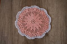 Handmade peach/salmon crochet doily with a white rim.  Measurement: - Diameter - 7,87 (20 cm)  It will be a really nice decoration for small round table.  *The doily pictured is one of a kind and the exact one you will receive *Ready to ship worldwide  I do custom orders. Feel free to message me if you would like something specific (for example another color)!  My Etsy Shop: https://www.etsy.com/shop/MadameCrochetArt