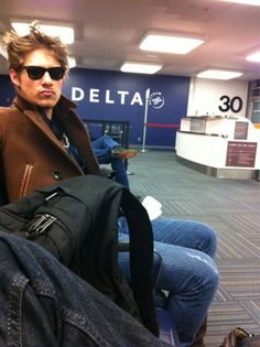 Because how can he look so sexy sitting in an airport?!