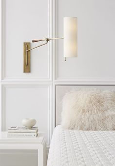 Modern luxe minimal bedroom. White, cream, antique brass, cabled winter white coverlet, ivory Mongolian lamb pillow. So calm and restful.