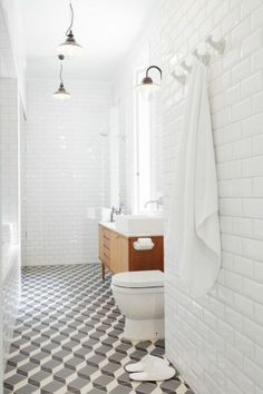white subway tile bathroom | Bevelled white subway wall tiles