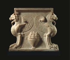A ROMAN MARBLE TABLE SUPPORT CIRCA 1ST-2ND CENTURY A.D.
