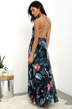 Lulus Exclusive! With the Next-Door Neighbor Black Floral Print Backless Maxi Dress in your repertoire, you'll be a dream come true! Gorgeous teal, coral pink, plum purple, and blue tropical print (atop black chiffon) shapes a backless, darted bodice with adjustable straps. Full maxi skirt boasts a sexy side slit. Hidden back zipper.