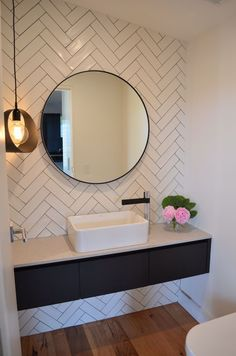 herringbone tile, round mirror, floating vanity, modern bathroom, powder room Visit us at www.ie for more fantastic tiling ideas! Bathroom Mirror Design, Bathroom Interior, Bathroom Lighting, Master Bathroom, Bathroom Mirrors, Bathroom Designs, Bathroom Pink, Bathroom Tile Patterns, Bathroom Wall Tiles