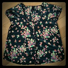 Black floral Top size Small Used condition. Light weight. 100% polyester. Great for Spring or summer. Cuff sleeves. Button down. No rips, no stains. Bellatrix Tops Blouses