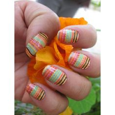 Adorable kente cloth-inspired nails.