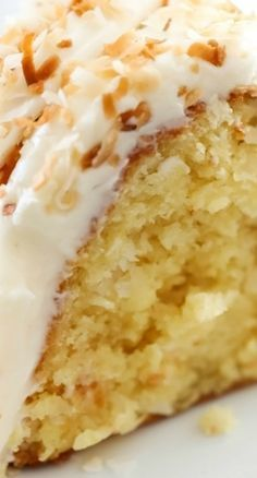 Coconut Bundt Cake ~ This is an incredibly moist cake loaded with coconut flavor... The Cream Cheese Frosting on top is the perfect pairing - This cake will be loved by all who try it!