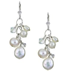 Earrings showcase a cluster of luminous white freshwater pearls and two sparkling iridescent genuine crystalsJewelry is handcrafted of fine .925 sterling silverStylish earrings features a textured oval link chain with fringe