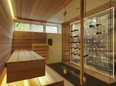 This sauna has a view of the unique wine storage shelf with a topographical pattern