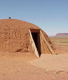 Native American Shelter Hogan A hogan is the primary traditional home of the Navajo people. Other traditional structures include the summer shelter, the underground home, and the sweat house. It is usually round and cone shaped, but now they make them square, with the door facing east to welcome the rising sun for good wealth and fortune.  The hogan is considered sacred to those who practice the Navajo religion. The r