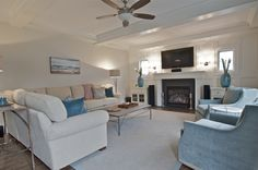 Bachelor Beach pad has all the calming of the sea with out feeling too feminine. Custom swivel chairs and sectional