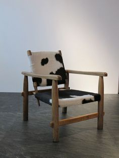 Charlotte Perriand; Wood and Cowhide Lounge Chair, 1955.